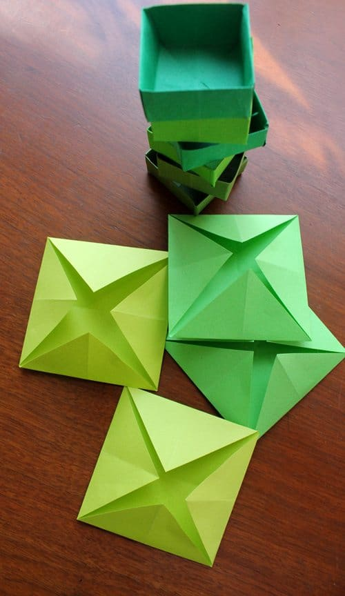 green folded paper pieces and paper boxes
