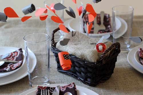 Gratitude centerpiece with paper hearts and secret messages on Thanksgiving table