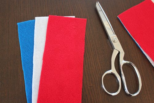 red white and blue felt and a pair of scissors