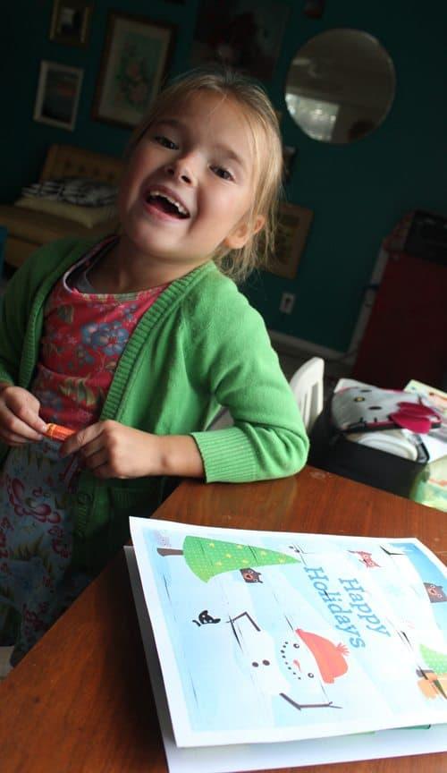 Child smiling next to Advent Calendar Printable craft