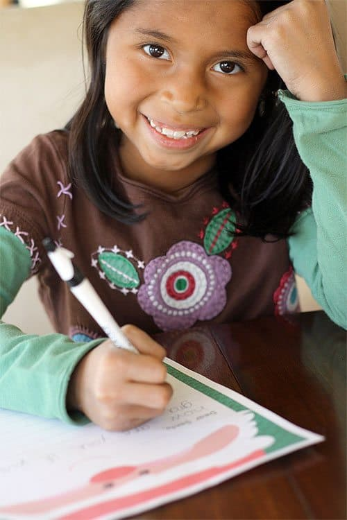 Smiling child writing a letter to Santa