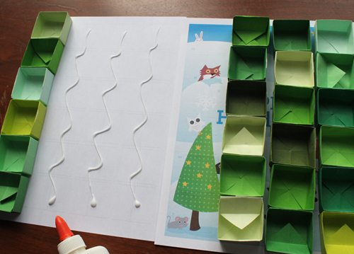 Gluing tiny paper boxes for Advent Calendar Printable craft