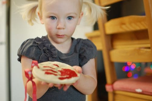 Child holding salt dough ornament