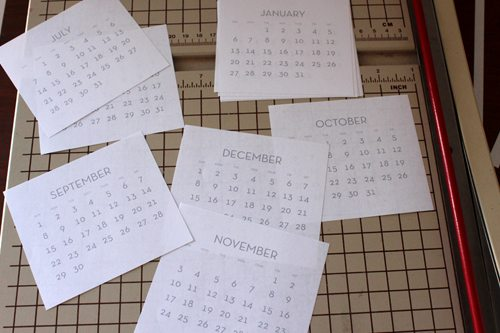 mini calendar pages on a cutting board