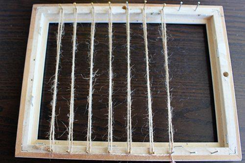 Stringing nails on frame for Abacus Menorah