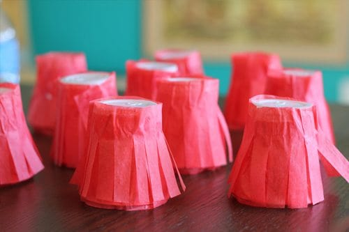 Paper cups with red tissue paper fringe