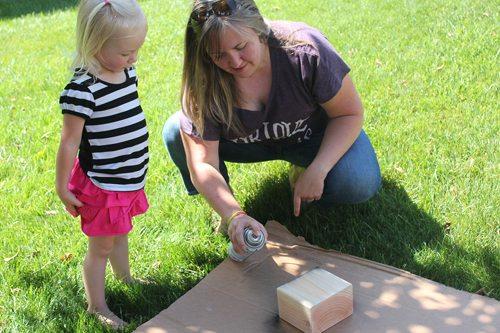Spray painting wooden block