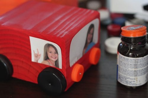 adding photos to wooden block with glue