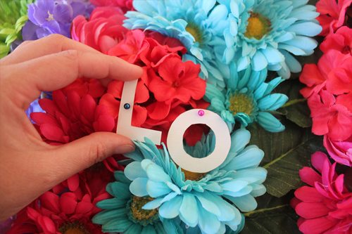 adding paper letters to flower craft