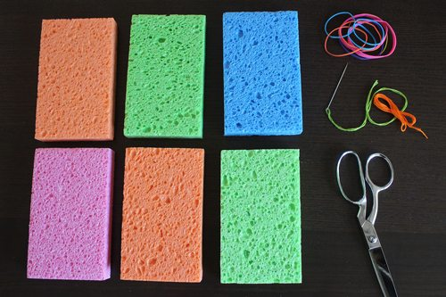 Supplies for Sponge Animals craft (sponges, scissors, needle, thread)