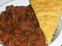 turkey and black bean chili with side of cornbread on plate