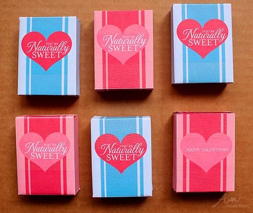 "6 ""You're Naturally Sweet"" Raisin Box Classroom Valentines on a table"