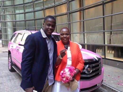Teddy Bridgewater standing with his mom in front of her new pink Cadillac Escalade