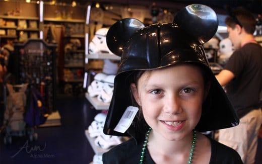 Child wearing Star Wars hat