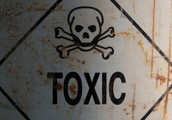 rusty toxic sign with skull and bones