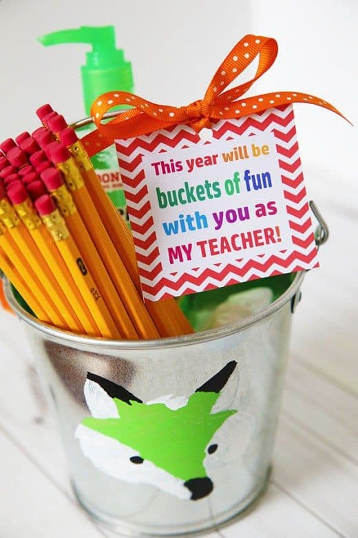Bucket decorated and filled with teacher's supplies with gift tag for teacher's gift