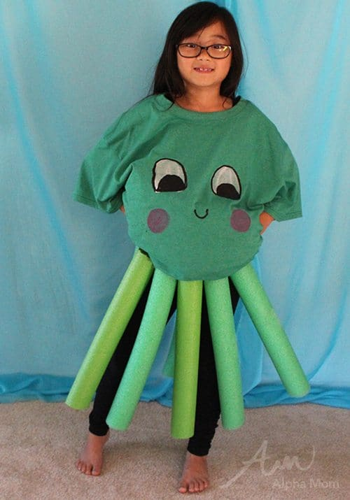 a girl with glasses wearing a DIY octopus costume made from an oversized t-shirt and pool noodles