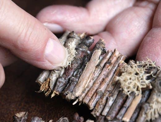 Gluing moss onto pieces of stick