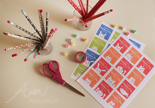 Friendly Valentine Card Printables on a table with pencils in cups and a pair of scissors