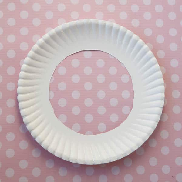 paper plate with the middle cut out on a polka dot table cloth
