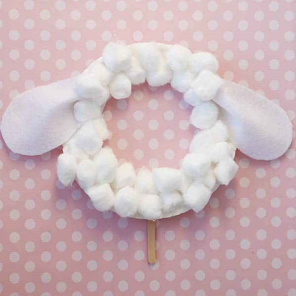 felt ears and cotton balls glued to paper plate
