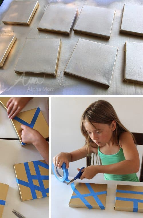 child using blue tape on gold canvases to create art