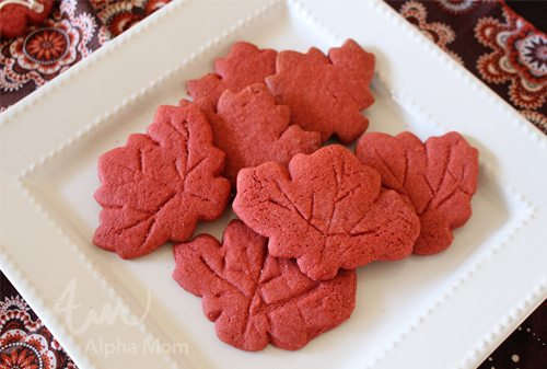 Red Maple Leaf Cookies on a White Plate
