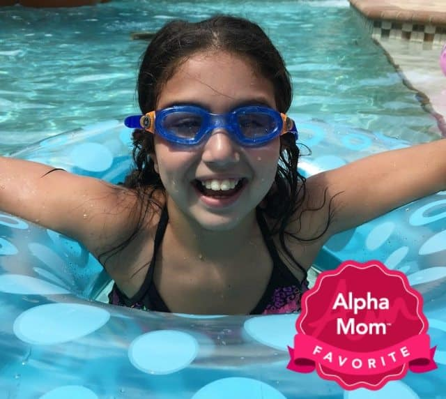 A tween girl swimming and wearing Aqua Sphere Moby Kids sunglasses