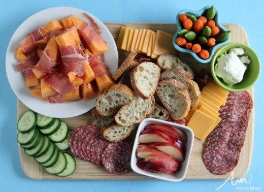 Food tray with meats, veggies, bread, cheese and fruit