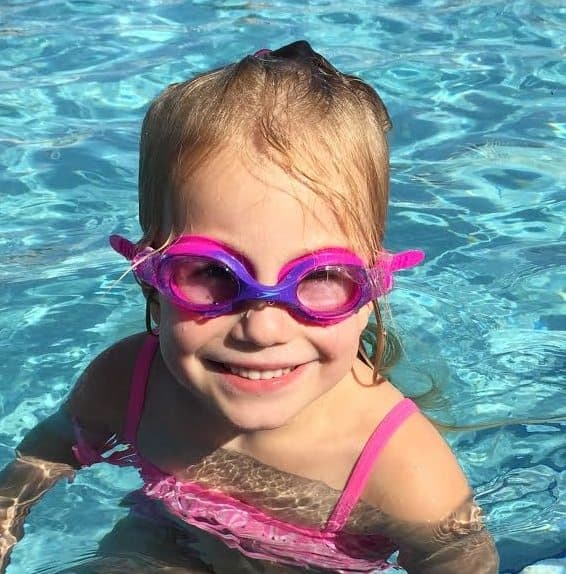 A young girl wearing Speedo Skoogles Kids Goggles