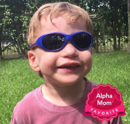 A toddler boy wearing purple Real Kids Explorer Sunglasses