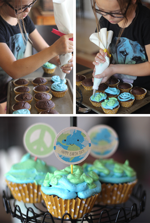 Decorating and frosting earth day cupcakes