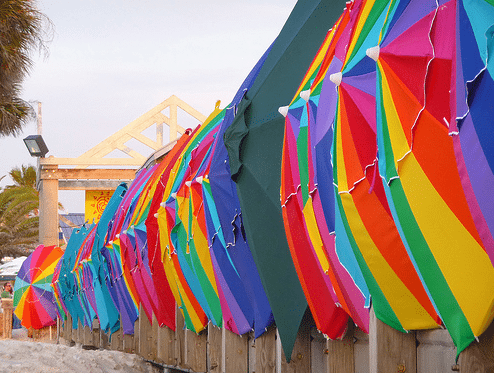 a row of colorful umbrellas at the beach