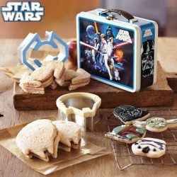 Sandwiches that have been cut with Star Wars shaped Sandwich cutters laying next to a Star Wars lunchbox