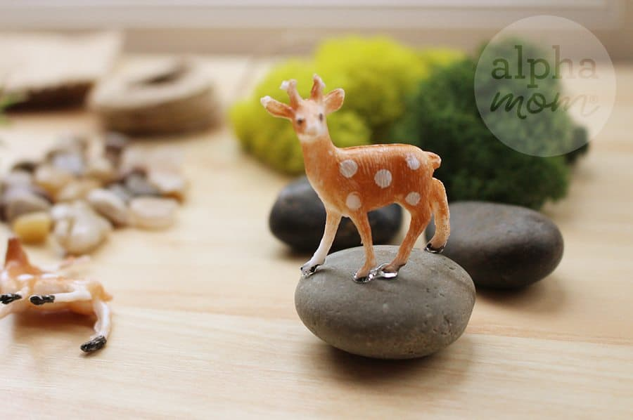 Holiday Teacher Appreciation Gift: Terrariums with Adorable Gift Tags (FREE and for download) by Brenda Ponnay for Alphamom.com (gluing reindeer onto stone)