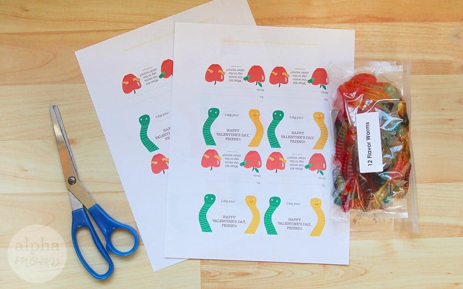 Scissors, gummy worm valentine's printable and a pack of gummy worms