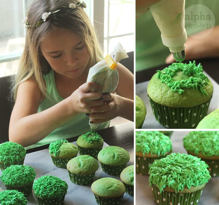 Child icing green cupcakes with green frosting