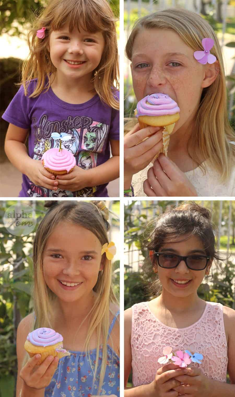 Four kids with spring cupcakes in hand