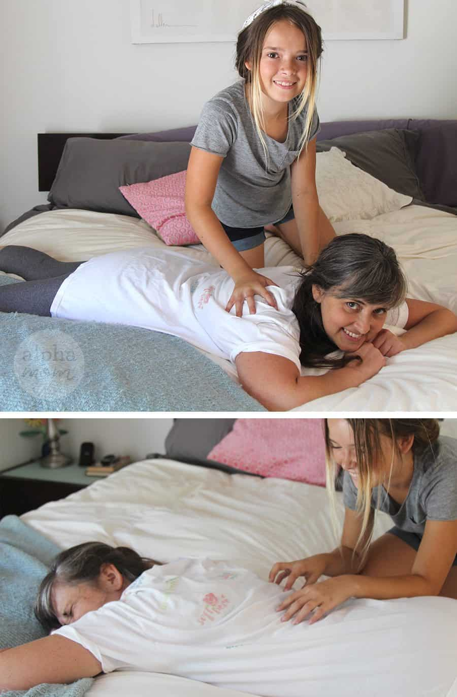 Girl giving mom a back massage