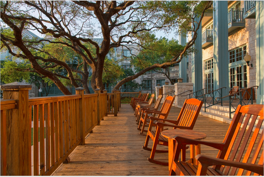 Rocking chairs lined up on a resort patio