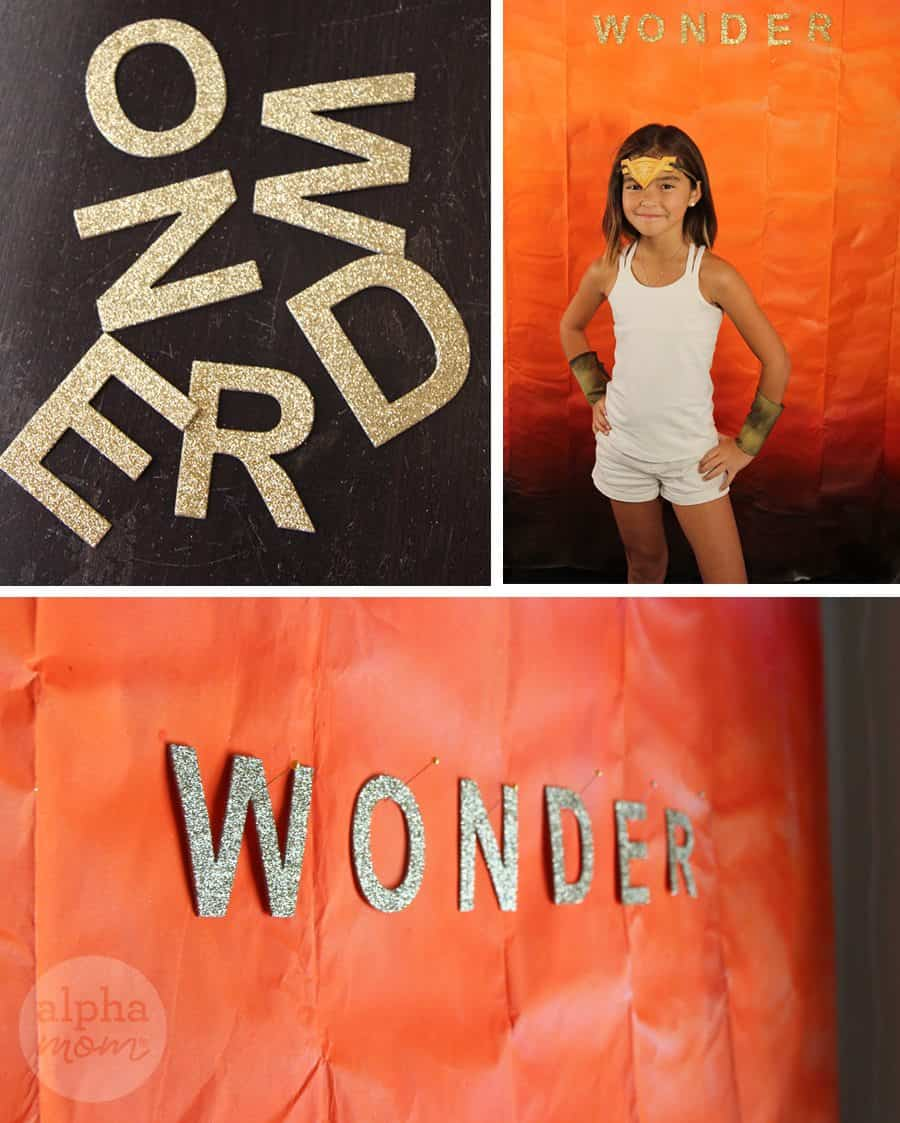 Wonder Woman Costume Party Photo Background (gold letters) by Brenda Ponnay for Alphamom.com