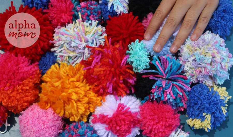 a pile of many different color pom poms