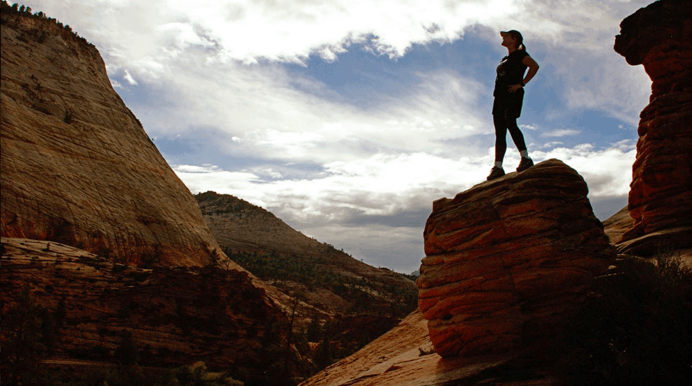 A women standing on a giant rock at Zion National Park