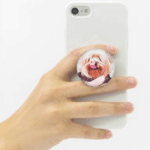 PopSocket: Put a stop to dropped phones with a PopSocket, a convertible grip/stand that attaches to your phone case. Choose from available designs, or customize your own.