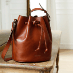 Sezane Farrow Bag: This leather bucket bag is big enough to hold everything and chic enough to go everywhere. Perfect for the nanny or babysitter who always carries a tissue and a toy for your kids.