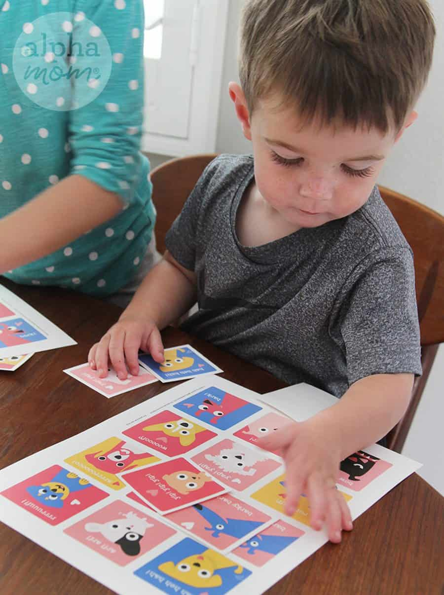 Child playing Puppy Valentine Printable matching game