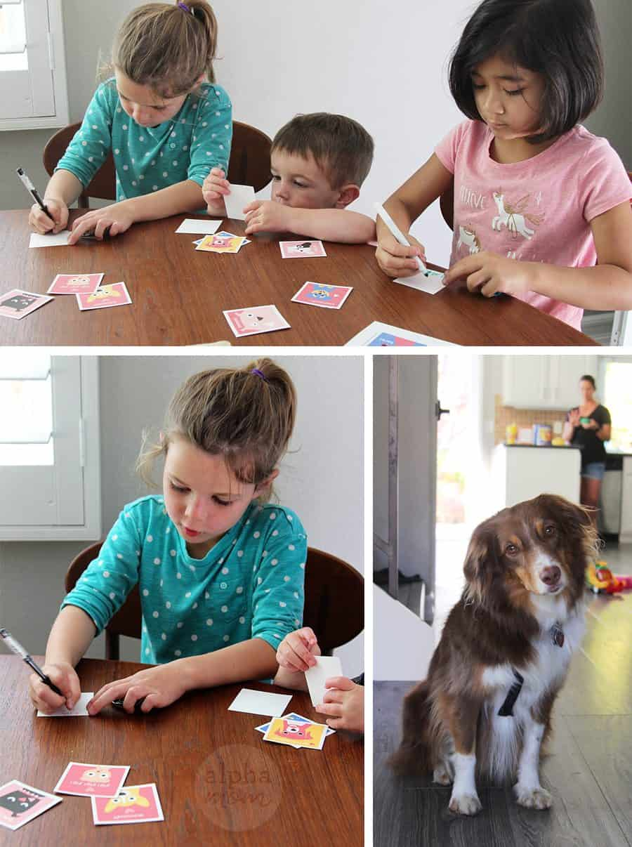 Children writing their names on puppy Valentine Printable cut outs