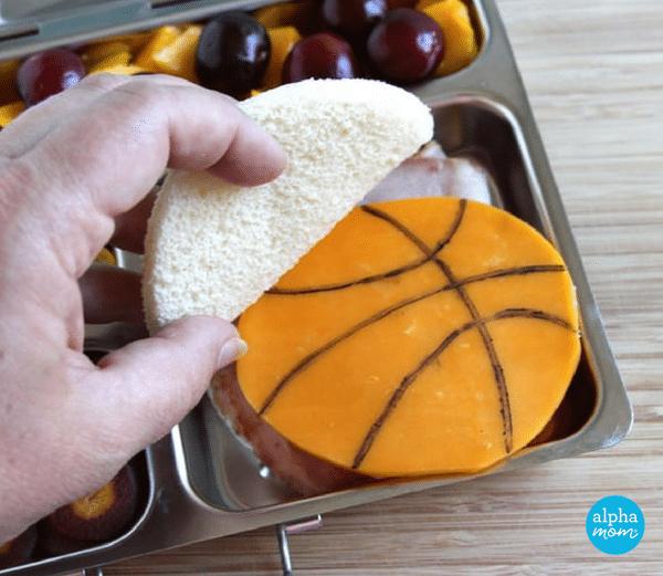 NBA Finals Bento Lunches: Cleveland Cavaliers colors (basketball sandwich) by Wendy Copley for Alphamom.com #NBA #Cavs #GSW #bentobox #bentolunch #kidslunch #basketballlunch