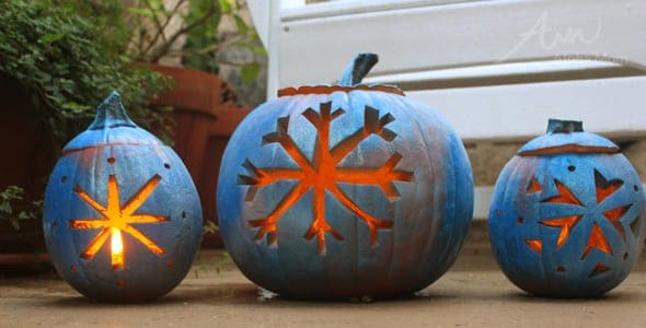 3 pumpkins carved with a Frozen Movie theme