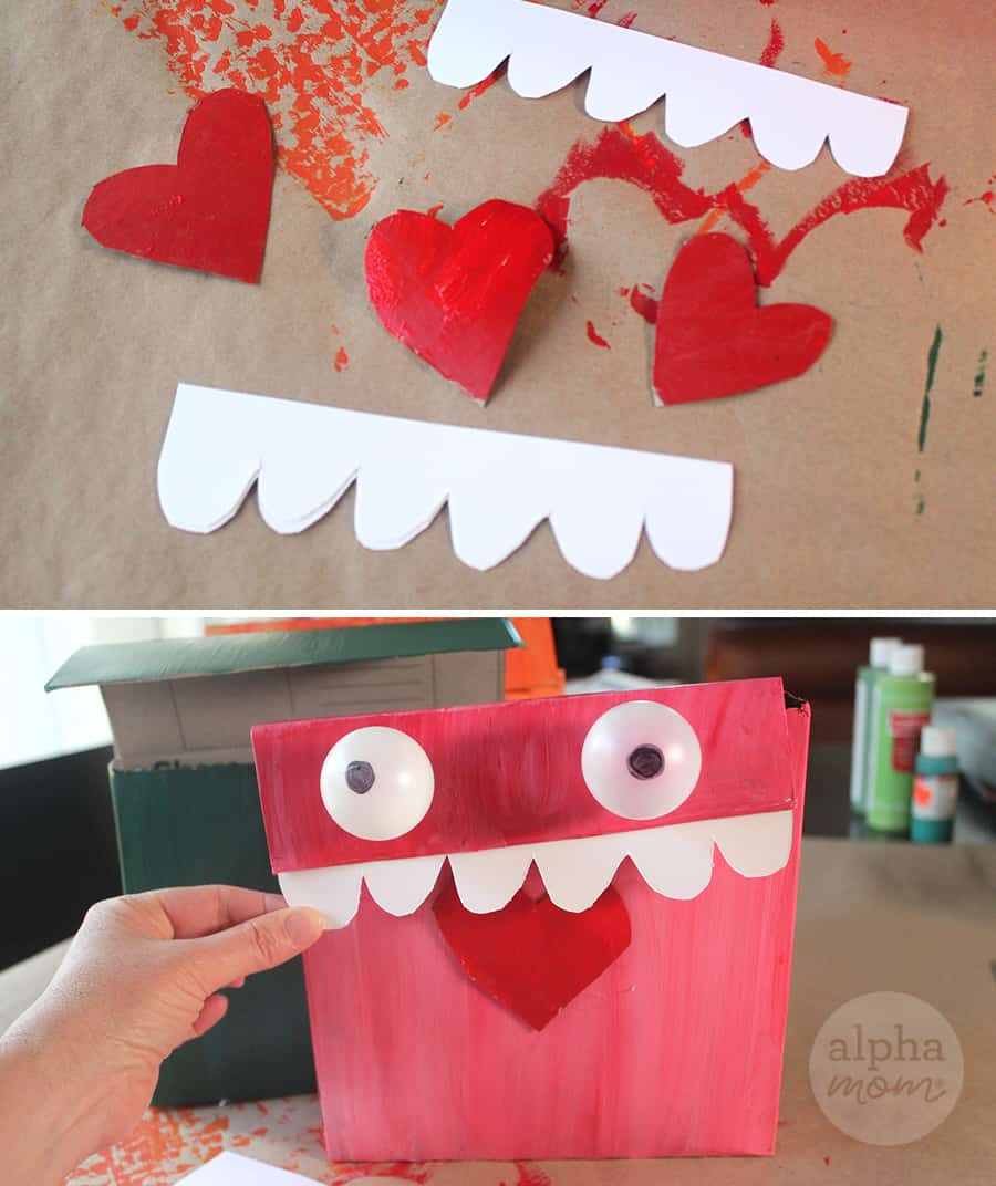 putting heart, paper teeth and ping pong eyes on Monster Valentine Mailbox craft